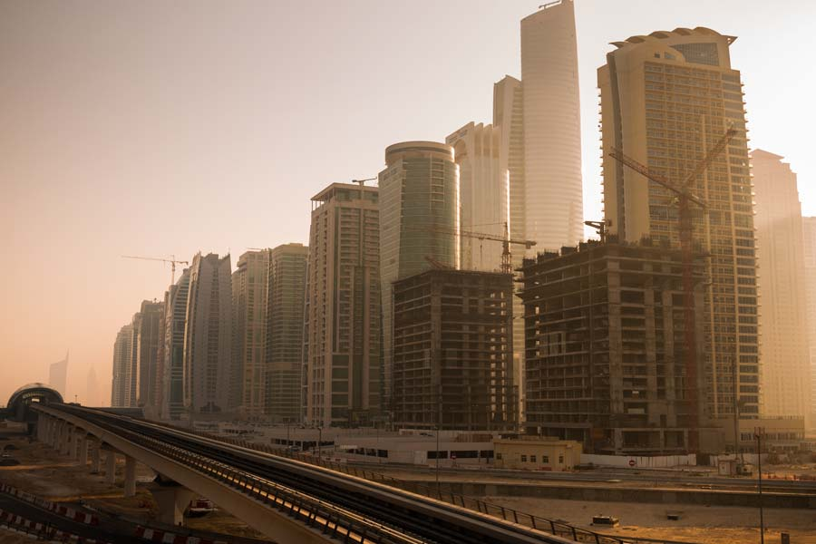 The morning sun takes a peek around the highrises on Sheikh Zayed Rd (E11 Highway)