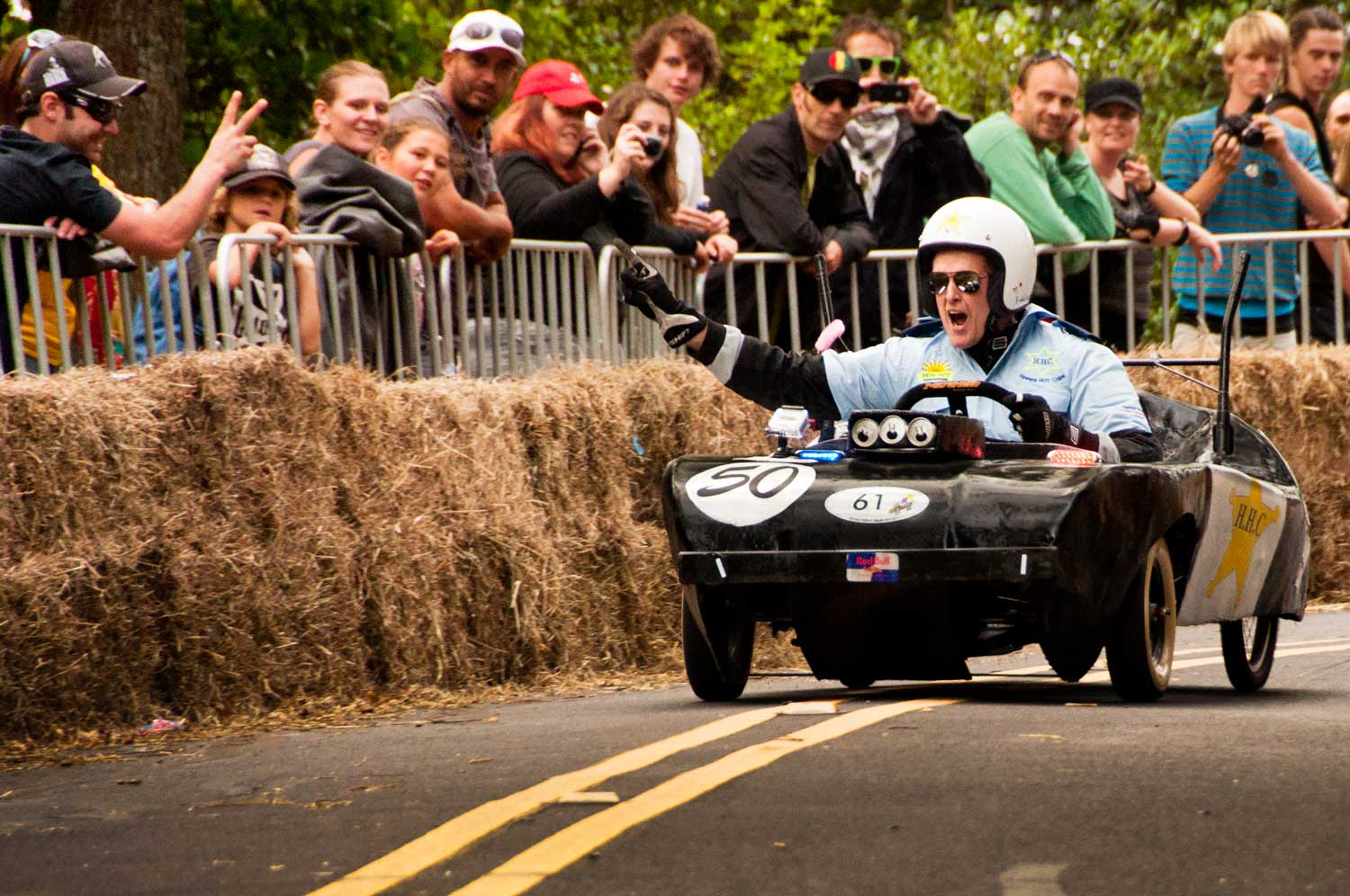 A happy driver completes the final bend that proved the undoing for much of the field.