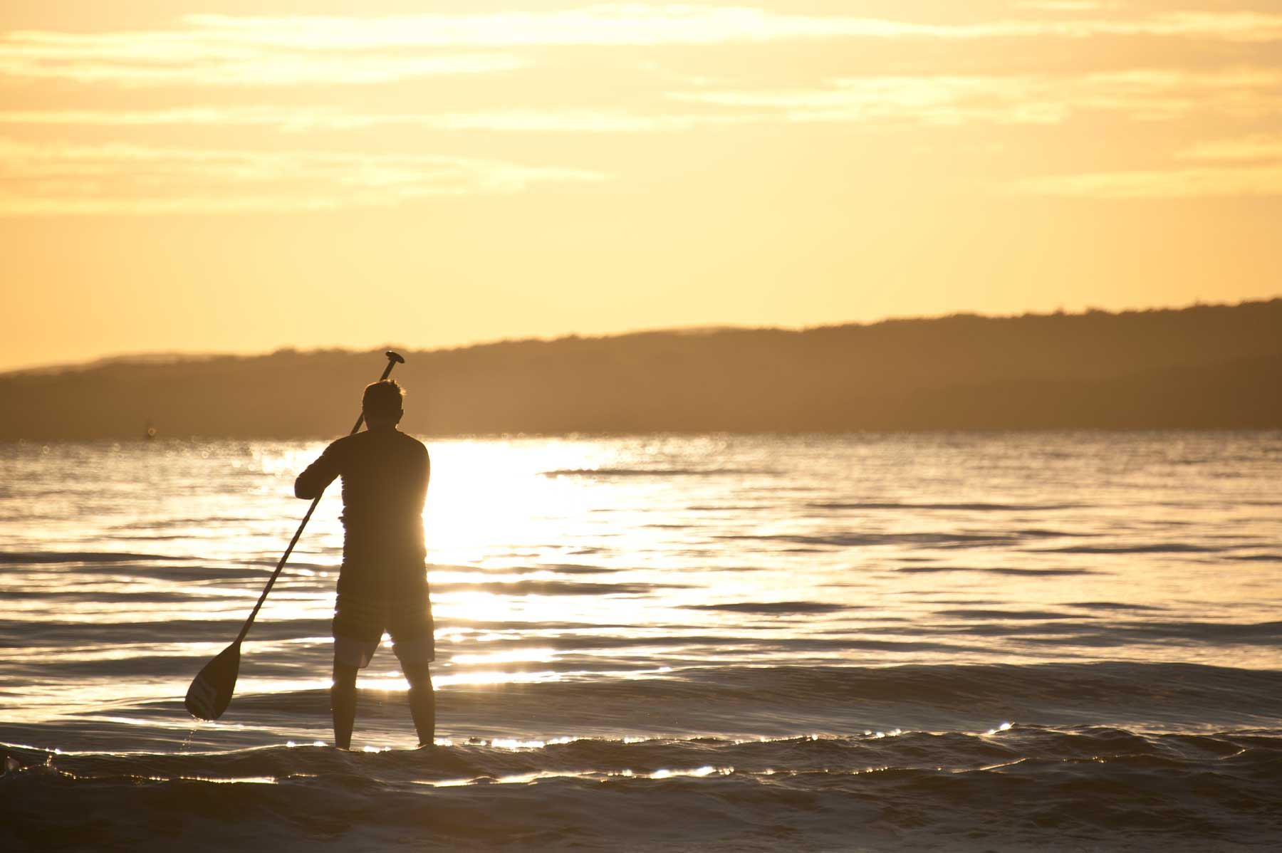 A paddle boarder sets off from Takapuna beach.