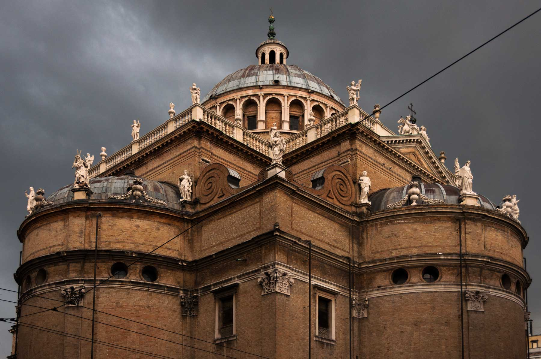 Clouds gather over the Basilica di Santa Maria della Steccata.