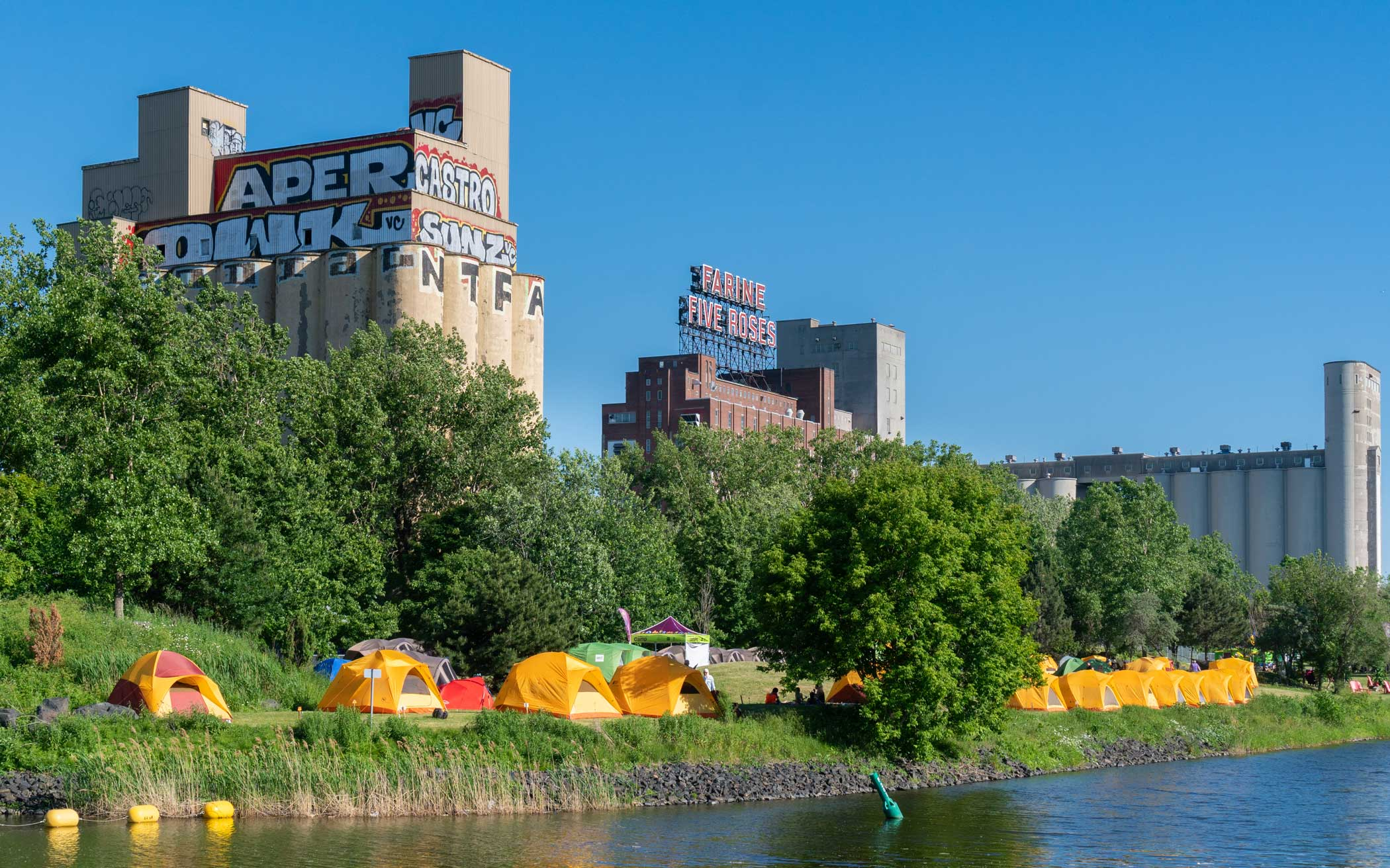 Tents line the park in front of Farine Five Roses on Lachine Canal.