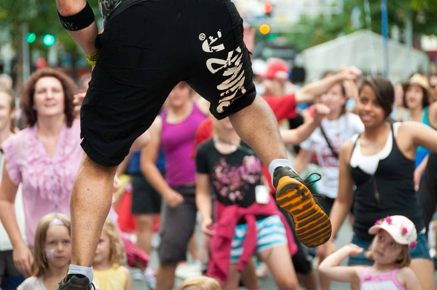An open Zumba session takes place at the base of Queen St.