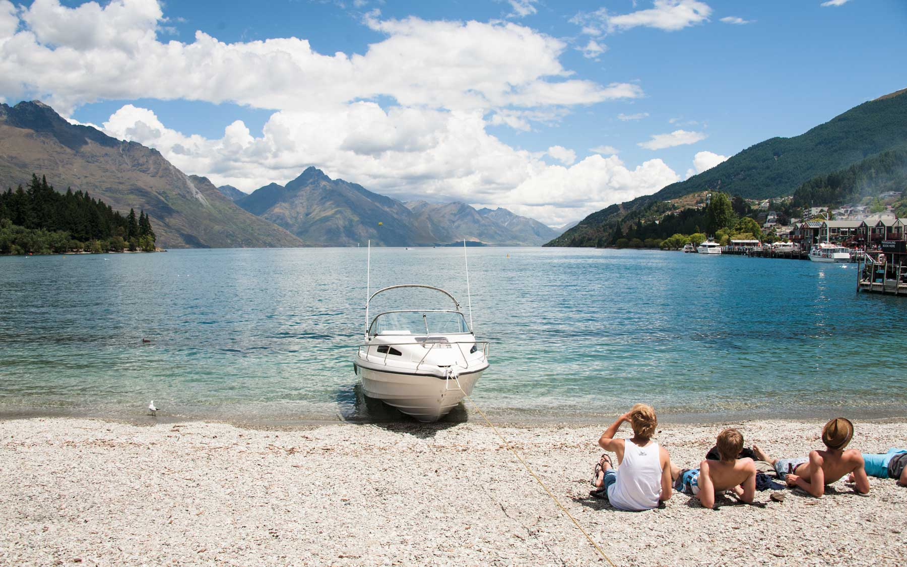 Revellers soak in the summer heat at Lake Wakatipu, Queenstown.